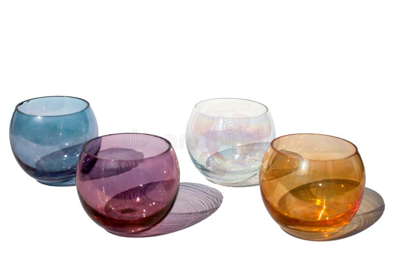 Four multicolored vintage round glasses on a white background with beautiful colored shadows in sunlight isolated close up. Four multicolored vintage round royalty free stock photo