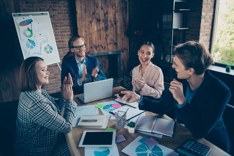 Four nice chic elegant cheerful staff business sharks experts presenting report congrats profit growth plan economy royalty free stock photography