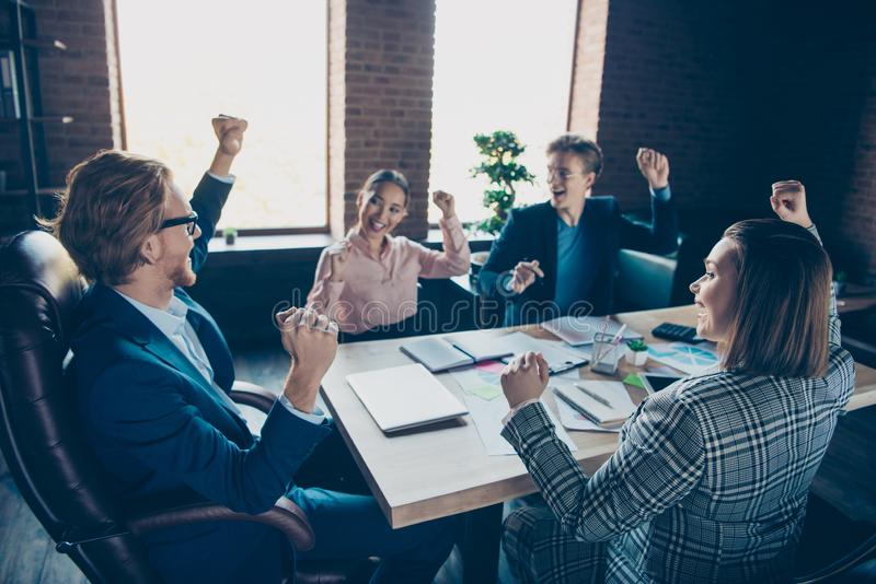 Four nice chic elegant stylish cheerful cheery business sharks experts celebrating rejoicing plan strategy growth profit stock photos