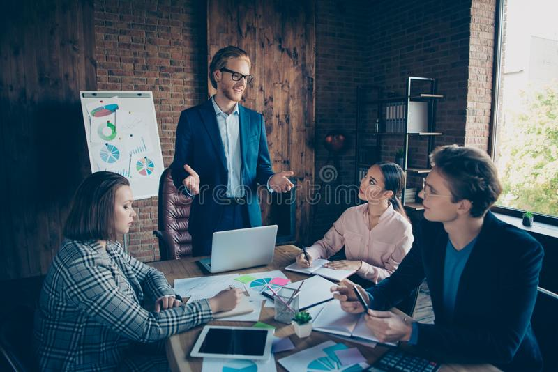 Four nice chic stylish elegant cheerful business sharks experts listening to speaker presenter saying speech at modern royalty free stock photos