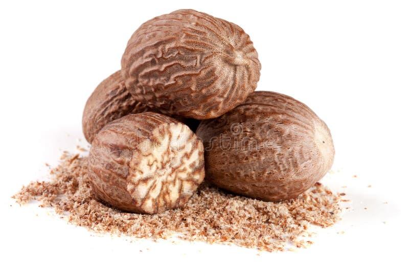 Four nutmeg and powder isolated on white background.  royalty free stock photo