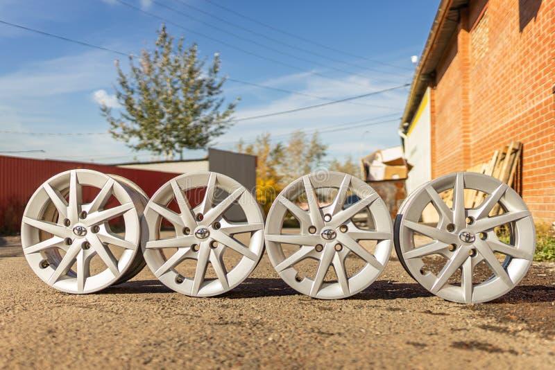 Krasnoyarsk, russia 12 jule 2019: four Old original aluminum Toyota prius wheels. Used, outdoors. royalty free stock photo