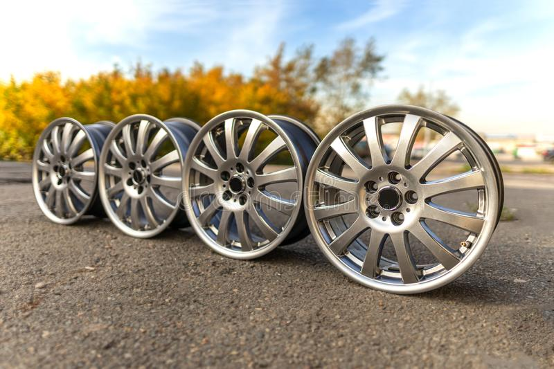 Four old stylish wheels. Used, outdoors. Summer. royalty free stock photography