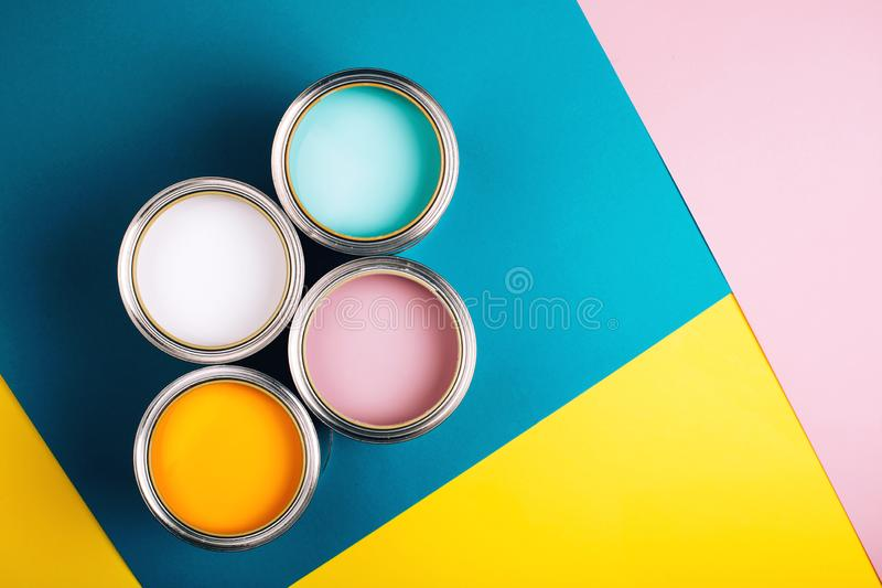 Four open cans of paint on bright background. royalty free stock image