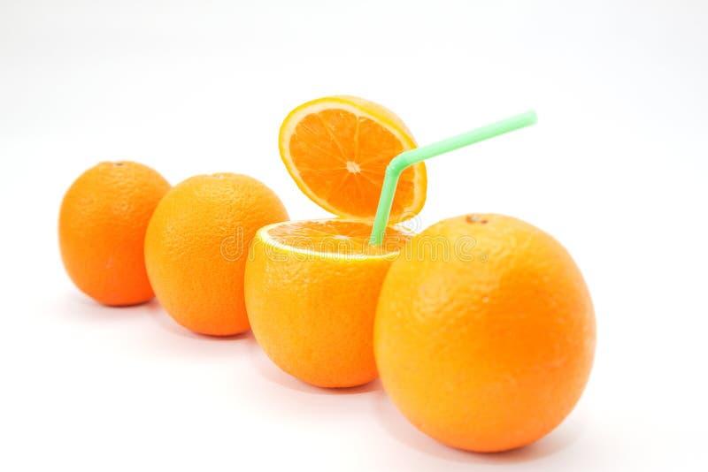 Four oranges on white stock photos