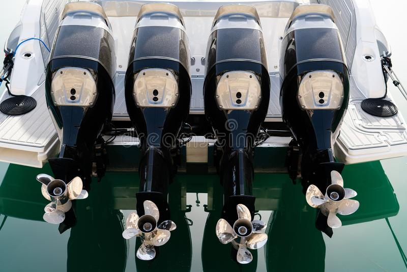 Four outboard motors. On a speed boat royalty free stock photos