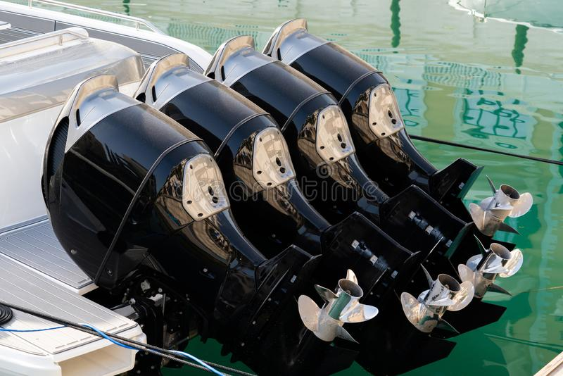 Four outboard motors. On a speed boat royalty free stock photography