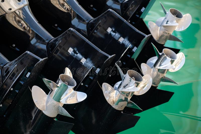 Four outboard motors. On a speed boat stock photos