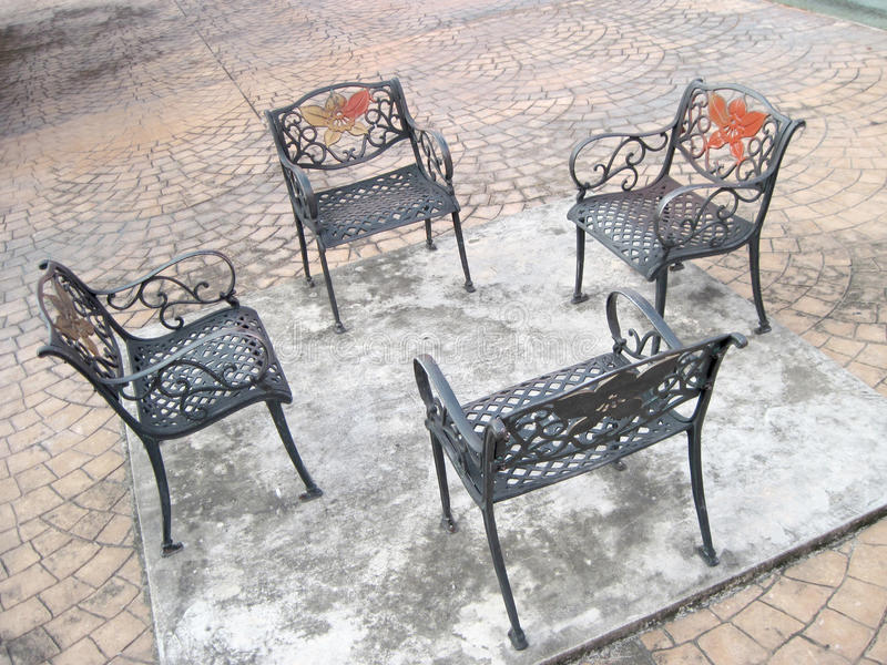 Four Outdoor Generic Public chairs royalty free stock photos