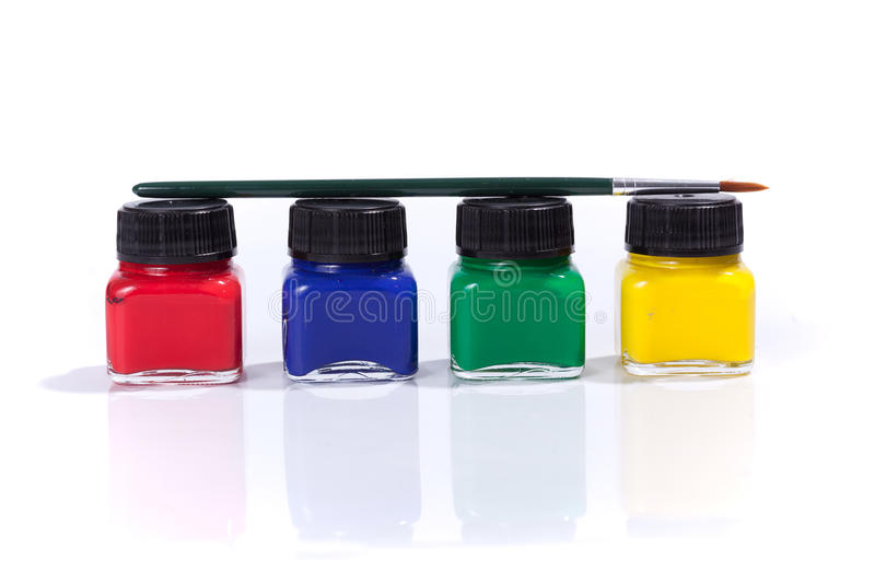 Four paint bottles in prime colors royalty free stock images