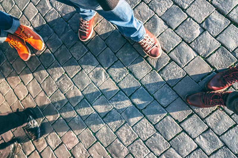 Four pairs of stylish shoes on the pavement background royalty free stock photography