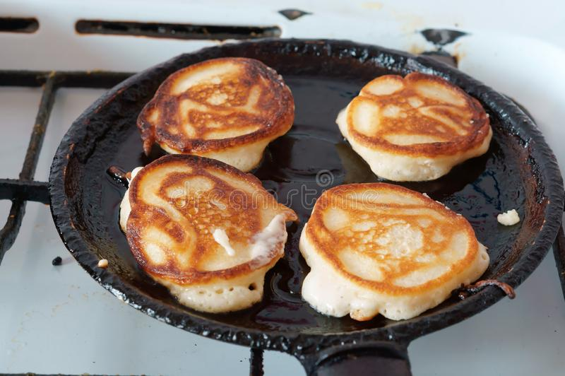 Four pancakes fried in a pan, cooking pancakes in a pan stock images