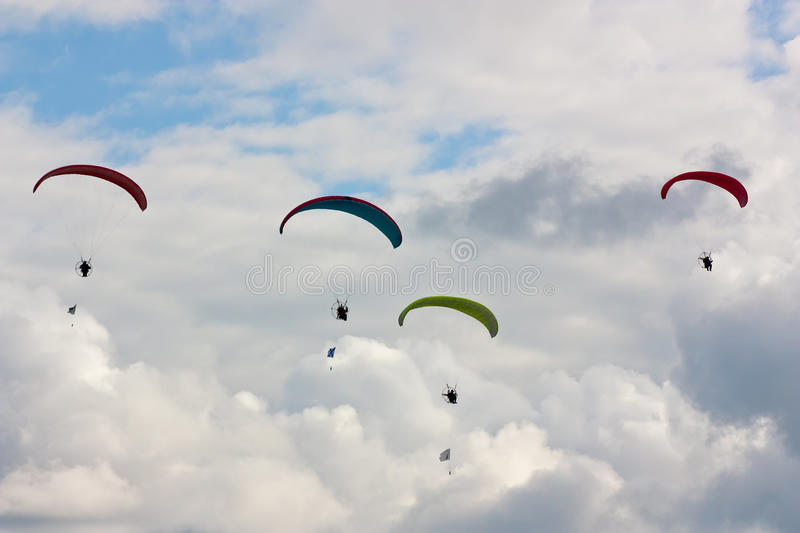 Four paragliders stock images