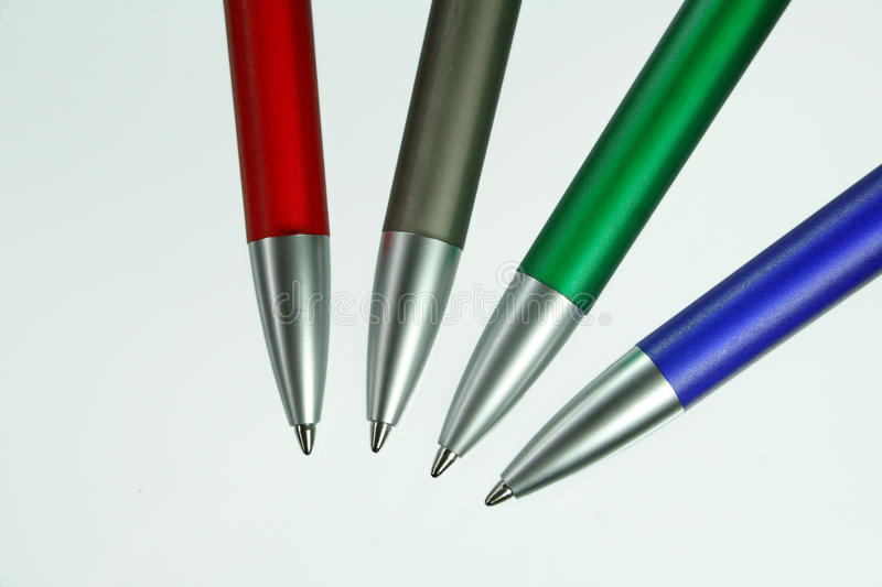 Four pens. In different colours for writings stock photos