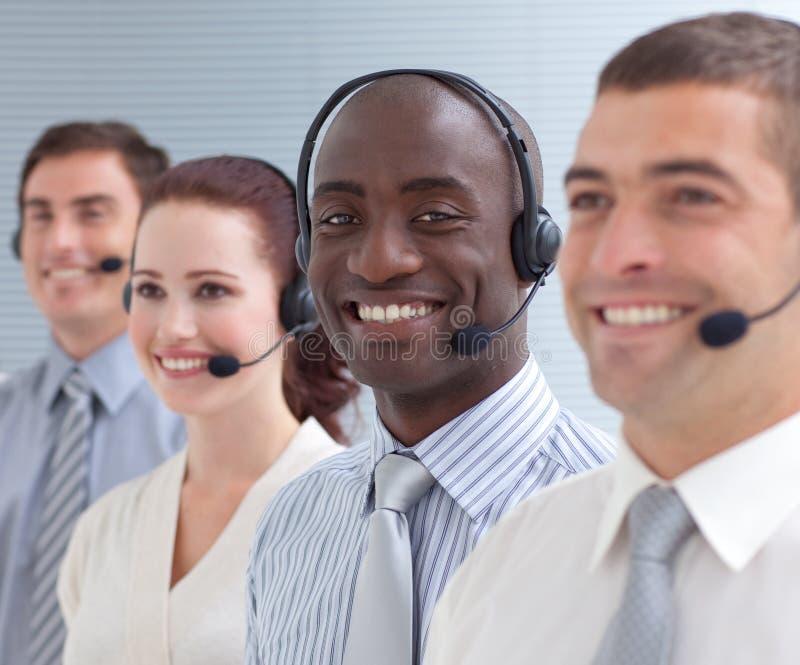 Four peolple in a call center stock photography