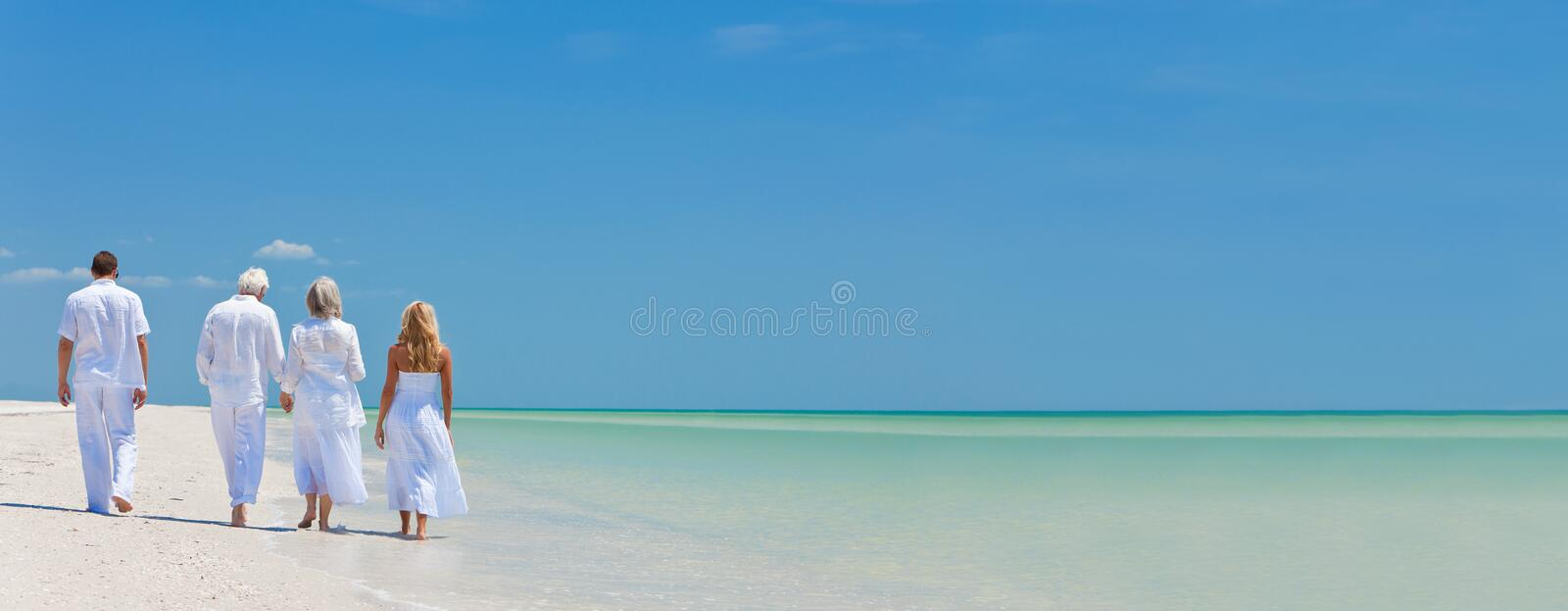 Four People, Two Seniors, Family Couples, Walking On Tropical Be stock photo