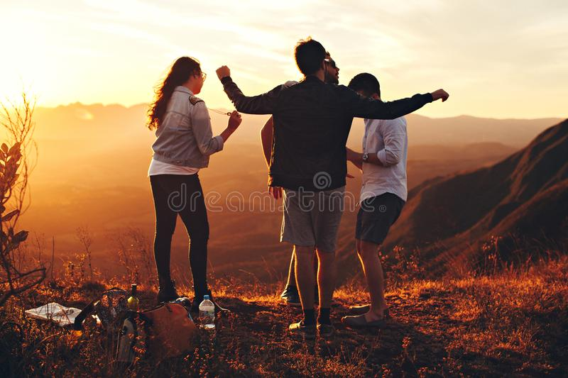 Four Person Standing At Top Of Grassy Mountain Free Public Domain Cc0 Image