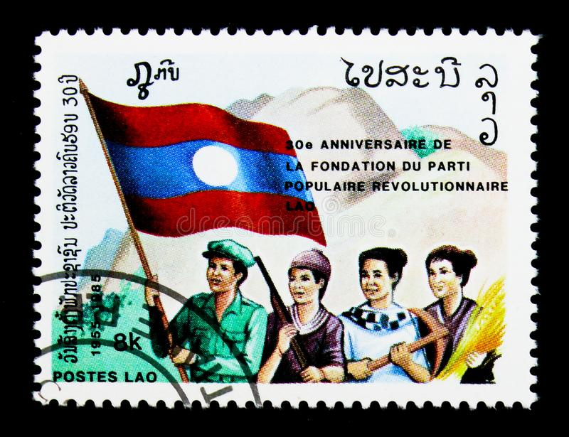 Four persons with flag, People's Revolutionary Party, 30th anniv royalty free stock photos