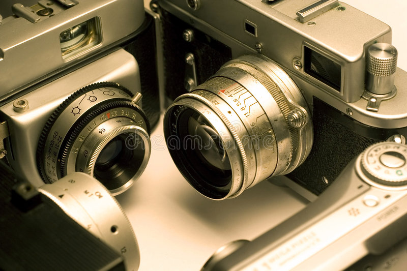 Four photo cameras royalty free stock photos