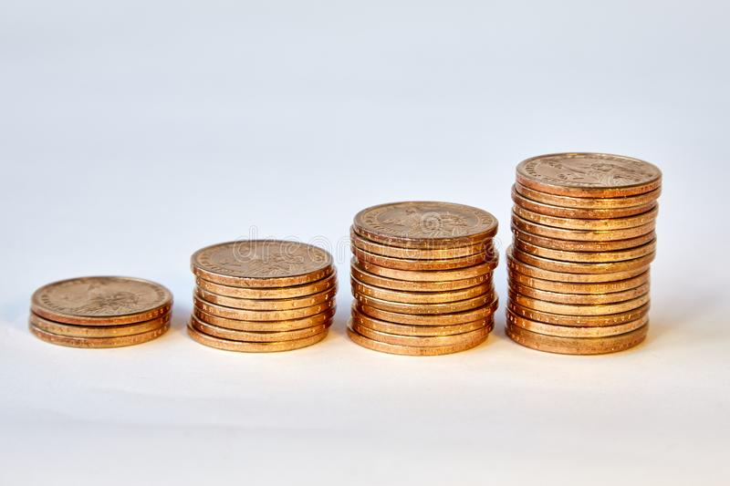 Four piles of yellow metal dollars of different heights. Symbol of revenue growth. Design element. . stock photo