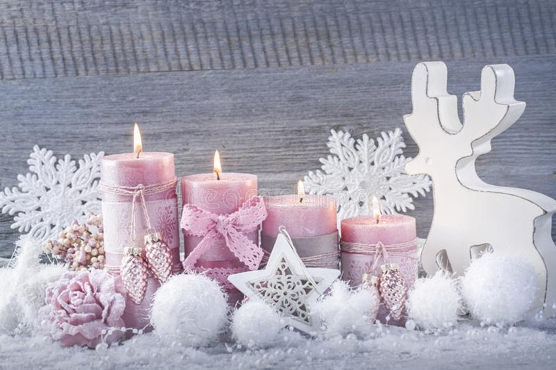 Four pink christmas candle. For advent stock image