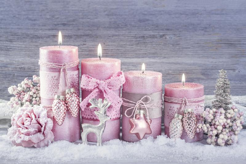 Four pink christmas candle. For advent royalty free stock images