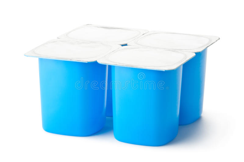 Four plastic containers for dairy products with foil lid stock photo