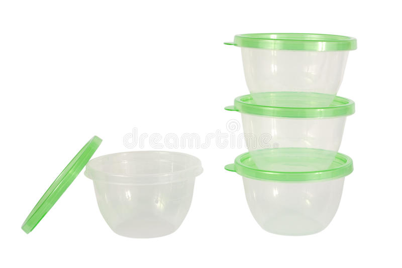 Four plastic storage containers. Stack of four green plastic storage containers isolated on white background royalty free stock image