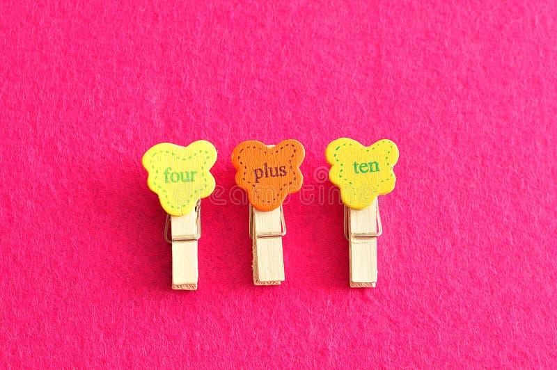 Four plus ten. On a pink background royalty free stock photos