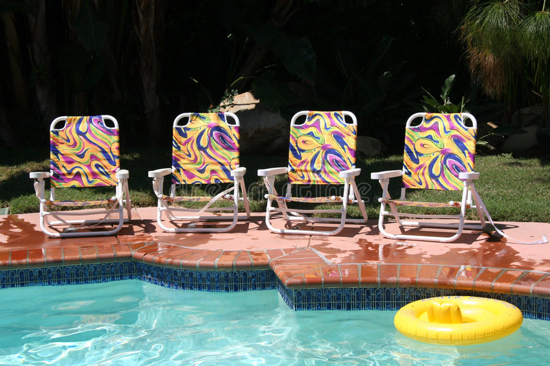 Download Four Pool Chairs stock photo. Image of resort, relax, lounge - 1099612