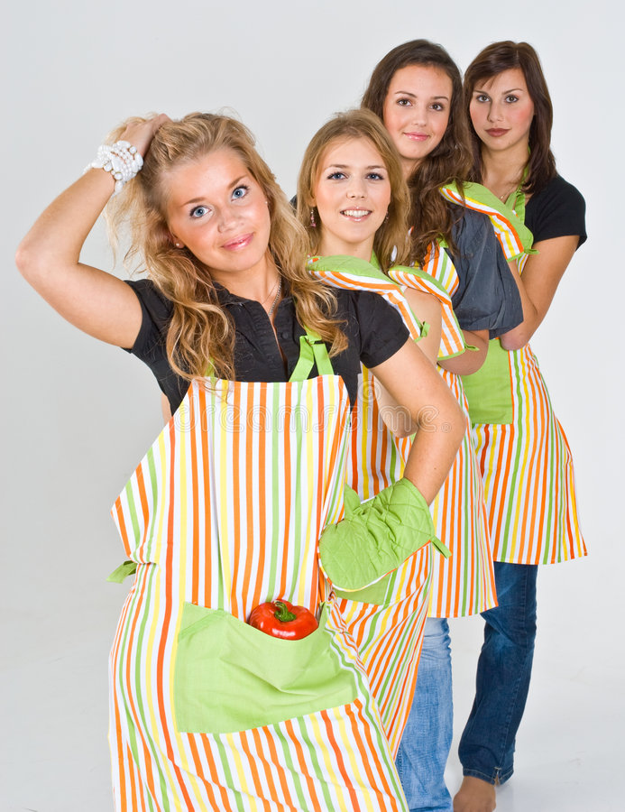 Download Four pretty teenage cooks stock photo. Image of preparing - 4931582