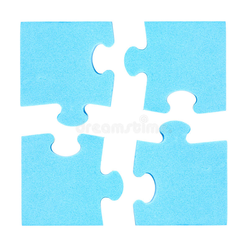 Four puzzle pieces combined cooperation concept. Isolated on white background royalty free stock photo