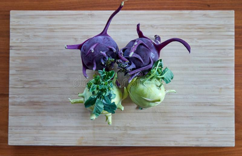 Four Raw Kohlrabi on A Bamboo Board stock photos