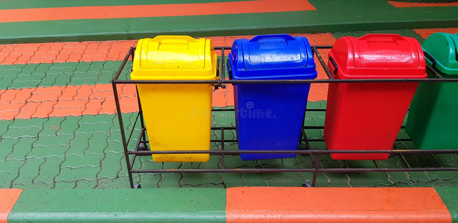 Four recycle bin, trash or garbage for dumping waste on footpath with copy space. Cleaning city, Green world, Nature, Reduce material concept royalty free stock photos