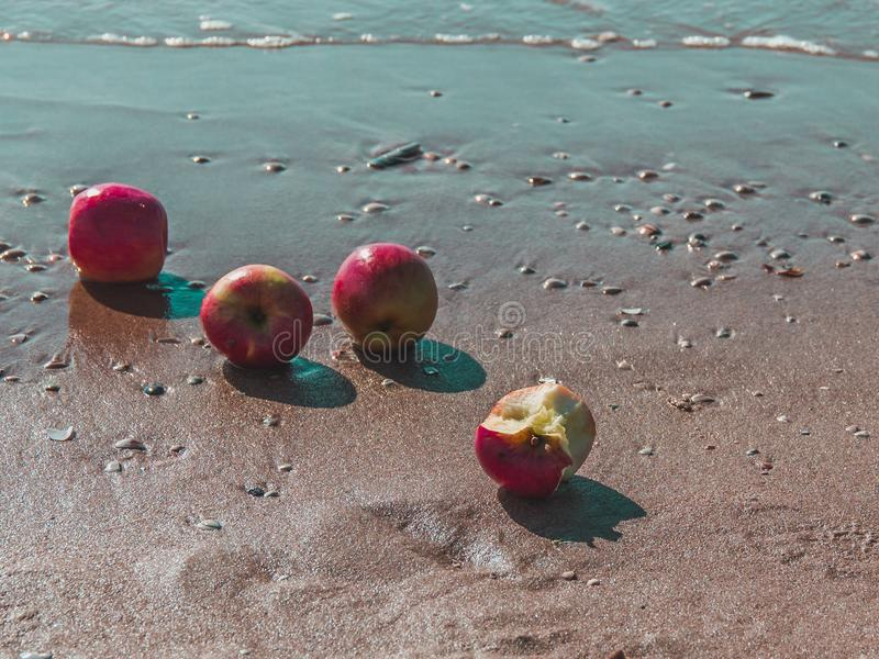 Download Summer Is Coming! Fresh Red Apples On The Sand At The Beach With  Stock