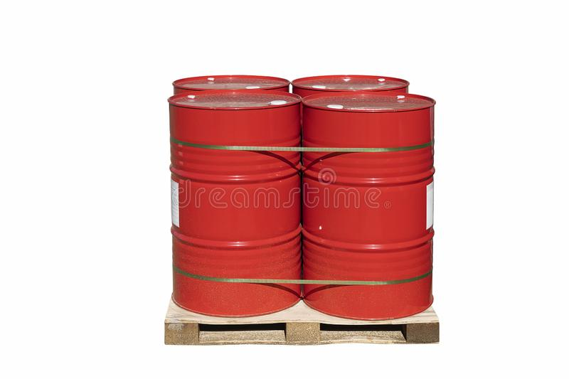 Four red barrels of 200 liters for liquid. Barrels stand on a pallet. Hazardous liquid in steel barrels. Isolated background royalty free stock photos