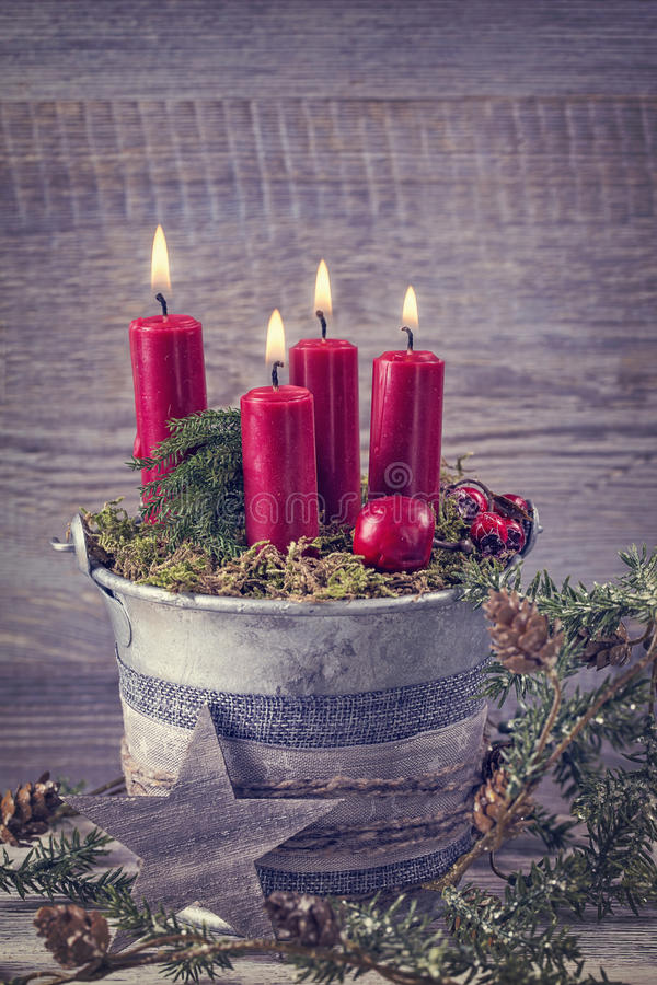 Four red christmas candles. For advent stock photo