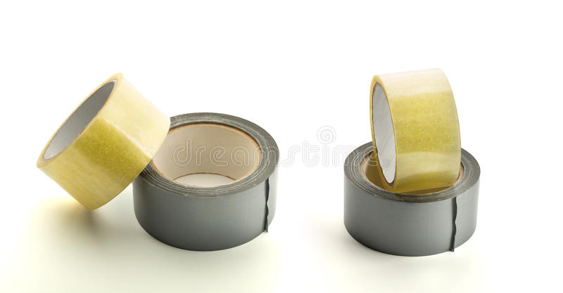 Four rolls of adhesive tape. On white background stock image