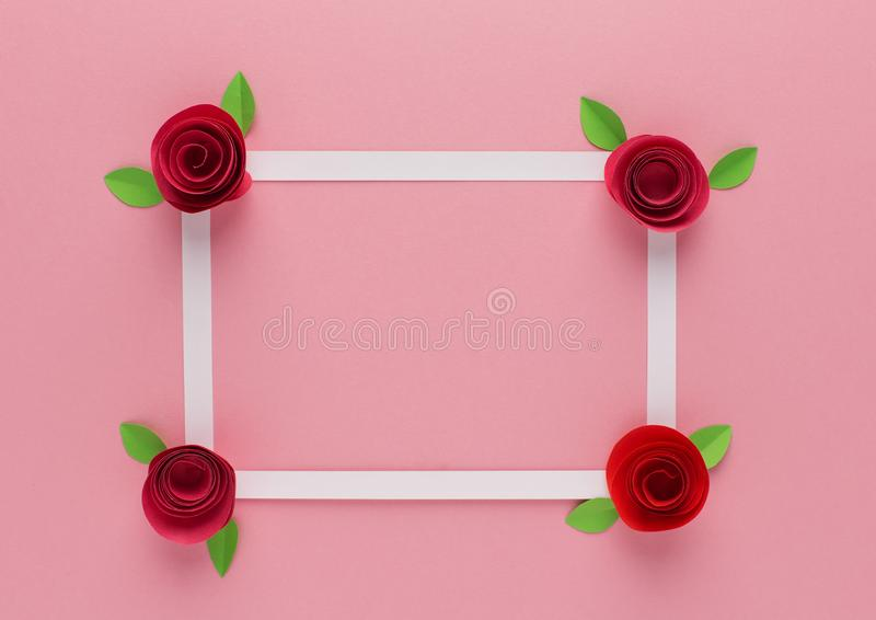 White frame and roses on pink background stock images