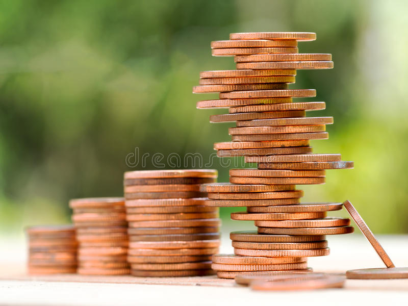Four rows of rising growth golden stack coins with unstable stack different position at last row showing high growth high risk stock photography