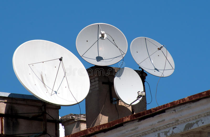 Four satellite dish antennas stock image
