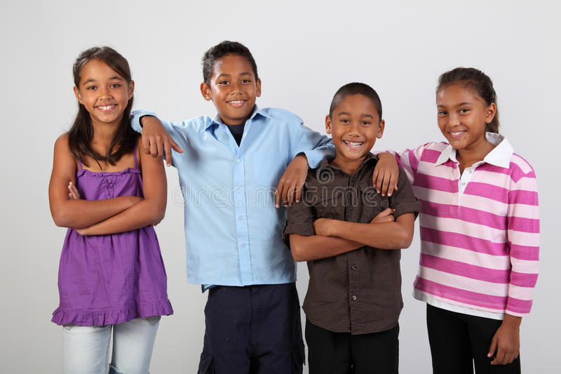 Four school friends share cheerful photo moment royalty free stock photos