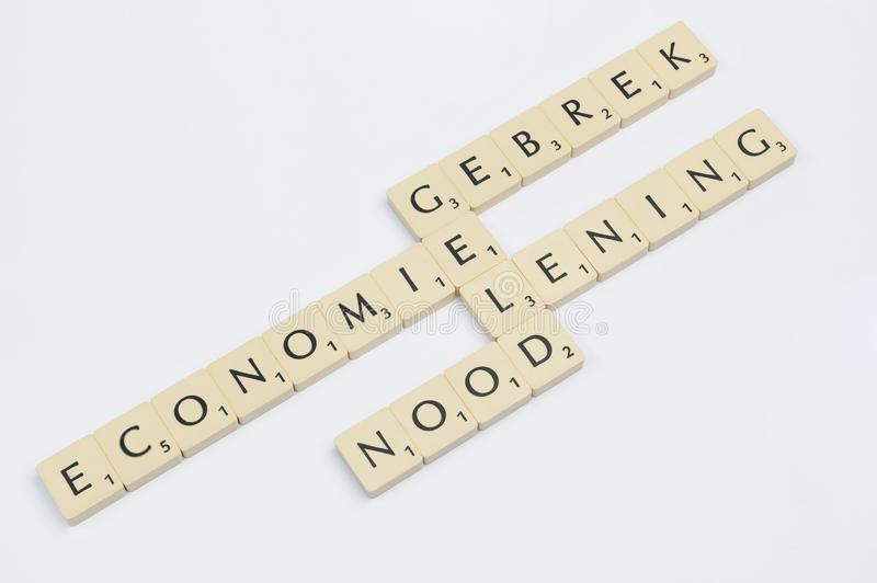 Scrabble words related to the word money in Dutch stock photos