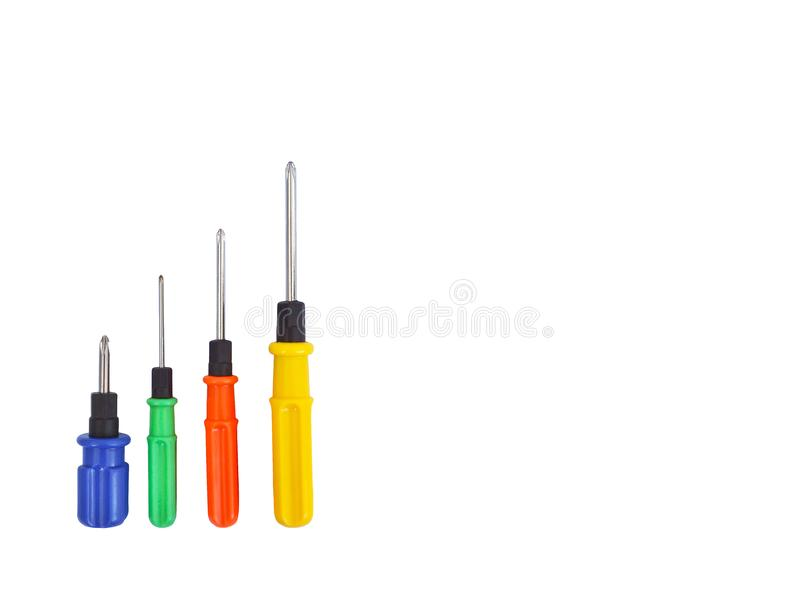 Four screwdrivers of different sizes with blue, green, red and yellow handles isolated stock images