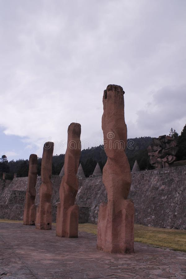 Four Sculptures in Centro Ceremonial Otomi, Estado de Mexico. These four sculptures are the focus of this image and in the back is the stone flower at centro royalty free stock photos