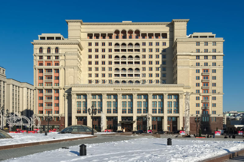 Four Seasons Hotel Moscow. Russia, Five-star hotel `Four Seasons Hotel Moscow`, Okhotny Ryad Street, 2, the view from Manezhnaya Square, cityscape royalty free stock photos