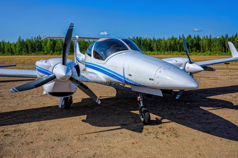 Four-seat light all-metal twin engine propeller-driven utility and trainer aircraft Diamond DA-42-VI Twin Star OH-DAB parked on royalty free stock photography