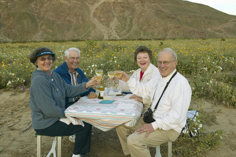 Download Four Senior Citizens Drinking White Wine Editorial Photography - Image: 26265242