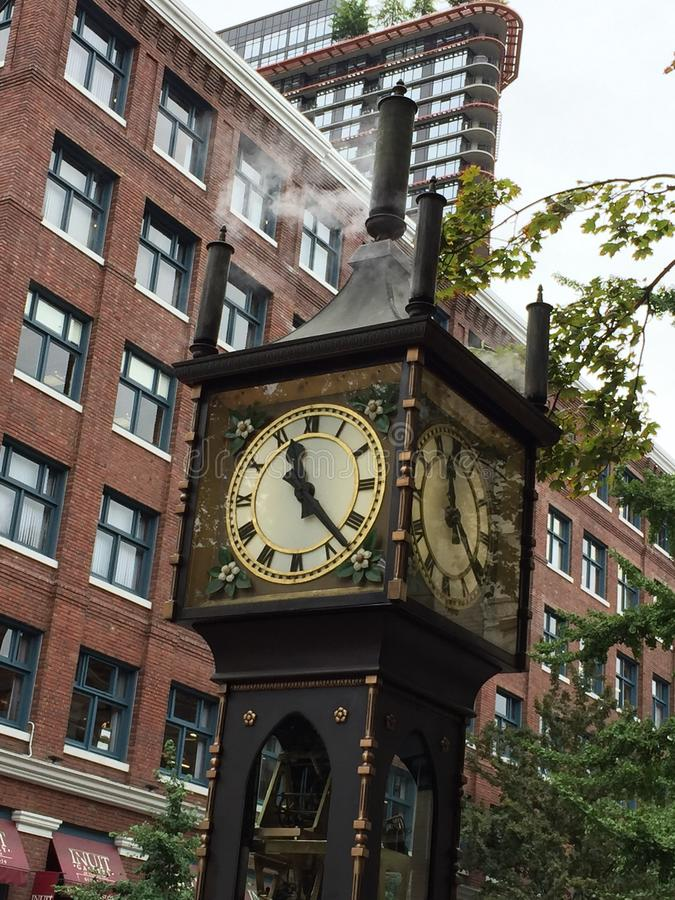 Four sides clock in Gastown, Vancouver. Four sided steam run clock in Gastown, Vancouver, British royalty free stock image