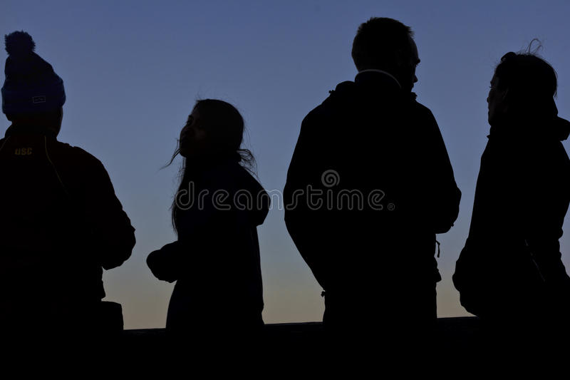Four Silhouettes at Sunset royalty free stock images
